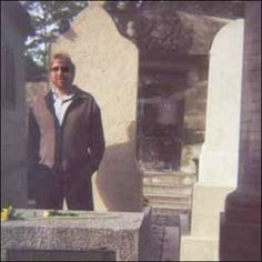 In 1997 rock historian Brett Meisner of Hollywood California visited the grave of former Doors front man Jim Morrison at the Pere Lachaise cemetery in Paris France. Meisner had a friend (Tom Petty)snap a photo of him standing by the grave.  The photo was packed away & never really looked at until one day in 2002 when Meisner came across an absolutely eerie discovery. On the right side of the photo plain as day is an image that closely resembles Jim Morrison.