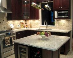 love this.  range hood and microwave in cabinet, good solution