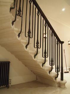 Stone staircase by the stonemasonry company.co.uk. The handrail is by Chris Topp blacksmith.