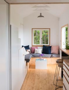 We spy some Città cushions in this Auckland couple's tiny house in Henderson Valley