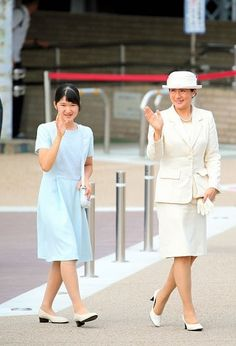 (L to R) Princess Aiko and Crown Princess Masako wave to well-wishers on arrival at Kashihara Jingu Station after visiting the the mausoleum of Emperor Jimmu on July 21, 2016 in Kashihara, Nara, Japan.