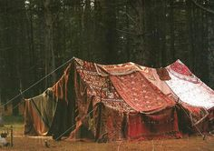 tent made of blankets and rugs - looks like a run down carnival