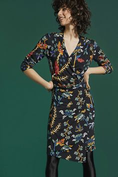 Desigual Women's long-sleeved black dress with floral print, crossover top and asymmetric hem. Check more about Desigual dresses!