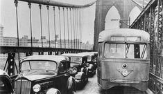Curvy 1930s cars and a trolley do the daily morning rush hour grind into Manhattan on the Brooklyn Bridge paved with cobblestones. New York. 1938 | Flickr - Photo Sharing!