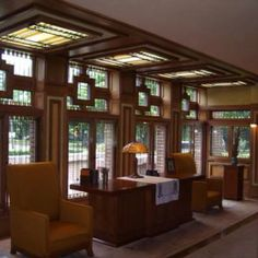Frank Lloyd Wright interior.....those windows deserve a single artistic chaise lounge or svelte fainting couch alone