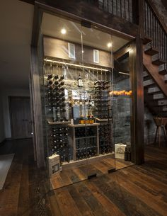 Ski chalet custom wine cellar featuring the Cable Wine System wine racking. What a way to end a day on the slopes!