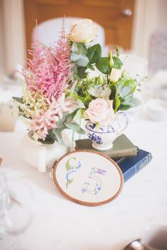 Image by Ferri Photography - Image by Ferri Photography - Bride in a Vintage Rose Wedding Gown with mis-match pastel Bridesmaid dresses for a whimsical wedding in an orangery with Homemade DIY decor & chocolate naked cake.