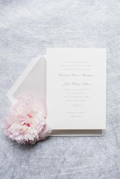 Mikkel Paige Photography photos of a downtown Raleigh wedding. Light blue details with planning by Sally Oakley. Classic white and silver invitation for a Market Hall reception.