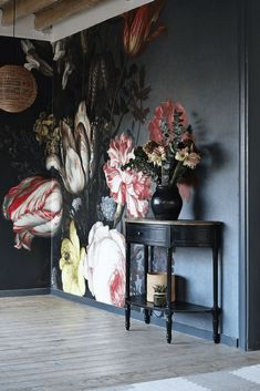 Bold floral wall mural on black background - dark and moody florals and unusual wallpaper are two of our top interior design trends of Read our feature for more ideas.