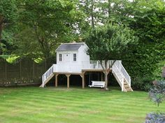 playhouse with swing seat , Raised playhouse with swing seat , Raised playhouse with swing seat , adorable_cottage_playhouse Adorable Costco Playhouse Hack Ideas to Steal Kids Outdoor Spaces, Kids Outdoor Play, Backyard For Kids, Backyard Projects, Backyard Playhouse, Build A Playhouse, Wooden Playhouse, Backyard Playground, Costco Playhouse