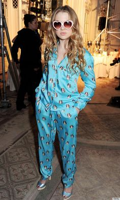 Anais Gallagher, daughter of Noel, wears silk pajamas to the Moschino Cheap & Cheerful show at London Fashion Week.