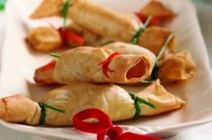 Feta and lime: 200g packet ready rolled filo pastry 50g (2oz) butter, melted Fresh chives Red pepper 25g (1oz) butter 1/2 lime, grated rind and juice 50g (2oz) feta cheese, crumbled 15ml (1tbsp) fresh coriander, chopped