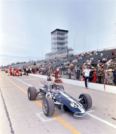 Dan Gurney leaves the pits at Indianapolis in 1966 in the first AAR Eagle Indy car built by his own company. Gurney's Eagles were some of the most beautiful race cars ever built.