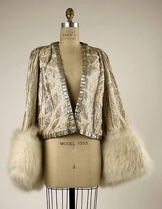 Jacket, Evening.  House of Worth (French, 1858–1956).  Date: 1930–32. Culture: French. Medium: silk, silver, fur. Dimensions: Length at CB: 21 in. (53.3 cm).