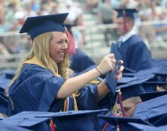 Nicole Michael of Hatboro shows off her diploma during the Shippensburg University Undergraduate Commencement on Saturday, May 5, 2012. (Public Opinion/Ryan Blackwell)