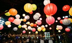 Brightly colored paper lanterns light up a room