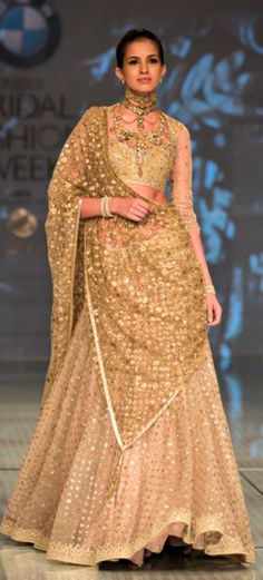 @nivetas The most spoken thing about an Indian wedding is, well, food! We are Indians! But that is not what I have in mind. I'm talking about wedding fashion clothing. Here are four astonishing golden bridal lehenga designs to make yours for your wedding day!