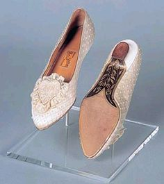 Princess Dianna's wedding slippers. A beautifully hand-tooled floral pattern was etched on the soles of each shoe.