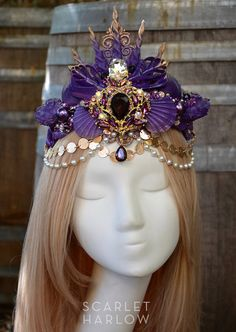 Purple shell mermaid crown is beautiful in person and wears easily, elastic band in back. Crown is for an adult. It is absolutely lovely and would be lovely for a photoshoot, or mermaid costume. 1 available, ready to ship. Follow me@ www.facebook.com/scarletharlowdesign