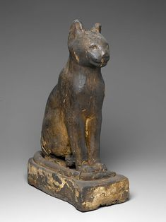 This wooden coffin held a complete mummified cat, an animal that became popular as a domestic pet in the first millennium B.C. and was associated with the goddess Bastet.