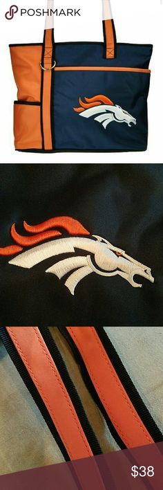 Denver Broncos Purse Size 13 in W x 10.5 in H x 4.25 in D Show your team spirit with this officially licensed Denver Broncos tote purse. Made of Microfiber material in Navy and Orange in color. Embroidered team logo on front. Right over the team logo, there is a ooen pocket for extra storage. Great for items like book or ipad. Side pocket. Top zipper closure to open main compartment. Inside side pocket.  Double straps. Double inner lining.  This is not a large tote, makes a good shoulder…
