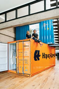 Creating separate spaces within an open floor plan with shipping containers