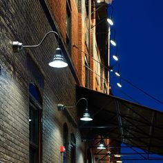 """In the early 1900's, an old warehouse in Spokane Washington known as """"The Cold Storage"""" building, was used to house perishables from the railroad which runs directly behind the building. Today, the building has been converted into a modern office space, loft style apartments and a retail/restaurant space. ANP Lighting provide both interior and exterior lighting solutions for this project"""