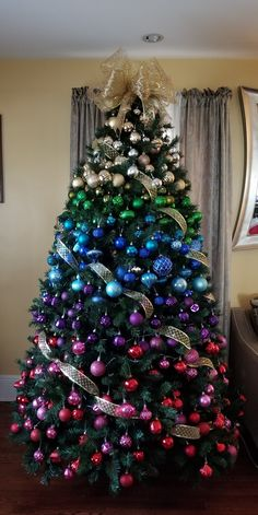 20 Gorgeous Christmas Tree Decoration Ideas: Colour Ombre A Chritsmas tree using all the colours to create an ombre gradient down from top to bottom of the tree. One of the ideas on the 20 Christmas tree list. Rainbow Christmas Tree, Flocked Christmas Trees, Ribbon On Christmas Tree, Beautiful Christmas Trees, Xmas Tree, White Christmas, Peacock Christmas Tree, Christmas Mantles, Victorian Christmas