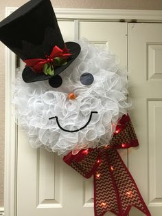 Large Frosty deco mesh with lighted bow! Made by Twentycoats Wreath Creations…