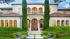 Enjoy Santa Barbara inspired living at the 6,574 square foot estate with beautiful grounds at 4236 Lorraine in Highland Park. This exquisite Santa Barbara Mediterranean showcases arched windows of German antique glass, solid Honduras cut mahogany doors, iron custom-stair railings and hand scraped wood and limestone floors. Terrace and balconies overlook the sparkling saltwater pool, spa and fountains.