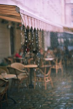 This picture speaks to me. It makes me want to be sitting outside a cafe in the rain.