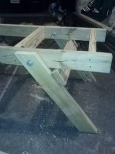 The legs of the new hive stand. These legs fold flat for transporting.
