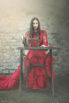 She sews clothes with an old sewing machine