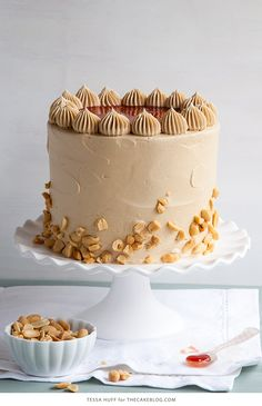 Peanut Butter and Jelly Cake | peanut butter infused cake, sweet strawberry jam filling and a brown sugar peanut butter buttercream that tastes just like honey roasted peanuts!