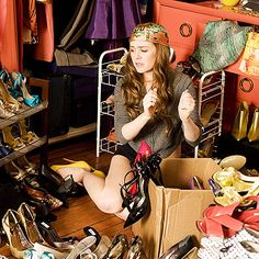 """Confessions of a Shopaholic Style: Closet Cleaning  """"I love this little outfit,"""" says Pat Field of the get-up Rebecca wears to clean out her closet. """"I did this look on Sarah Jessica Parker once in Sex and the City—it's sexy and cute."""" Of all the sky-high shoes she wears, Isla Fisher says, """"It was my idea to keep her in heels all the time because something about tottering in heels is always funny to me."""""""
