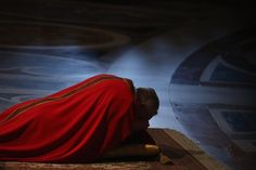 ROME - Pope Francis prays on the floor during a Papal Mass with the Celebration of the Lord's Passion inside St Peter's Basilica on March 29, 2013 in Vatican City, Vatican. Pope Francis is taking part in his first holy week as pontiff and will later today preside over the Way Of the Cross procession at the Colosseum in Rome.