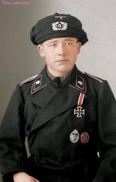 German Panzer Unteroffizier wearing his Iron cross 2nd class, silver Panzer badge, Bronze sport badge.