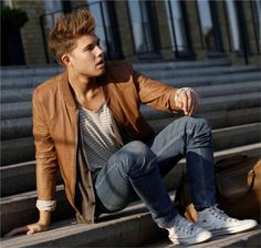 brown jacket with jeans plus converse