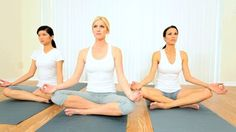 Multi-ethnic Female Group Practicing Yoga In Fitness Studio Stock ...