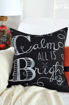 pottery barn christmas pillow: white fabric marker, black linen and a projector for copying