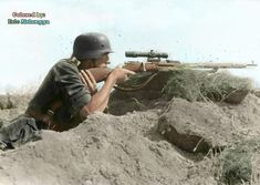 Heer sniper with the famous Russian Mosin Nagant rifle. Some time in the Eastern Front. The using of captured enemy weapons and vehicles was a common practice done between both sides during the war. Some of the reasons were to make them as war trophy or because they were favored by soldiers for their combat performance, or simply because it was necessary to have them.