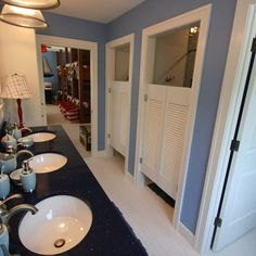 Whoa. Three sinks, two shower closets and seperate toilet. I would love this!