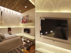 cama com televisao na frente e painel de gesso iluminado na lateral