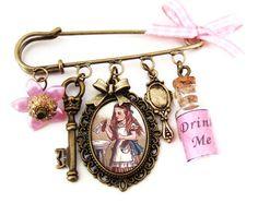 Alice Brooch:Alice in Wonderland Brooch Altered Art Kilt pin Alice Cameo. £17.00, via Etsy.