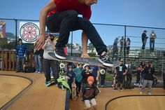 Balboa Skatepark creates space for skater community - Chris Jatoft, 22, transfers from the bowl to the quarter pipe at the Balboa Skatepark opening ceremony Saturday, September 29, 2012. Hundreds came to skate at the new park and hear live music. Photo by Andy Sweet / Xpress