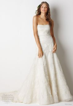 """Watters Fall 2011 bridal collection relaxed glamour wedding dress  -  Mackay Ivory silk organza strapless, fluted silhouette gown with pin tucks, beading and cotton lace bands traversing the body of the dress and 72"""" chapel train."""