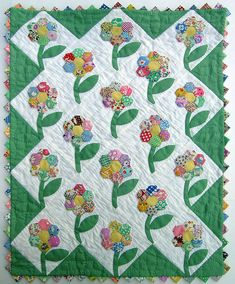 Flower Garden Applique Doll Quilt is a nice use of hexagons