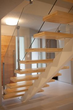 Stainless steel post and glass railings with open wood stair case - beatrice Stair Posts, Stairs And Doors, Stainless Steel Handrail, Loft Stairs, Glass Railing, Post And Beam, Stairways, Beams, Houses