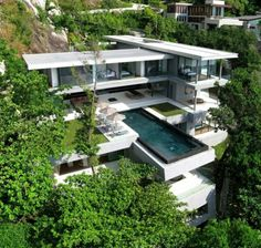 """Residential Architecture: Villa Amanzi by Original Vision: """"..The defining elements are the rock and the view. They dominate at every juncture. They resonate on first approach, through the migration from public to private space, in the living and in the family areas, in the gardens, in the bedrooms; and they continue to command respect down the tropical jungle steps that arrive at a secluded rock platform, flanked by the same seam that welcomed you 60m above. Constant reference to these…"""