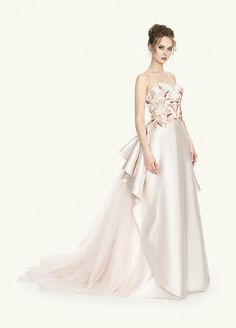 From Carlo Pignatelli Couture Bridal 2017. The Noel model. Heavy duchesse satin overskirt reproducing organ pipes, from which starts a long tulle train. Heart neckline and floral colorful embroidery for the bodice.